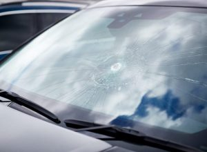 detail-of-damage-to-windscreen-of-car-shattered-by-VGQHXT6