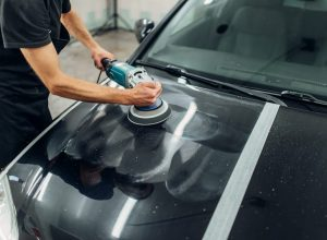 male-person-with-polishing-machine-cleans-car-958JQ4U