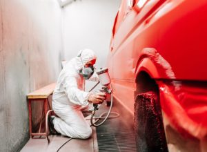 mechanic-working-on-painting-a-red-car-in-special--MMH7J4H