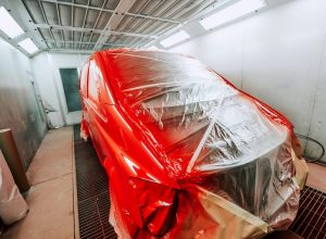 red-van-being-paint-in-special-paint-booth-car-pai-48RPSWS