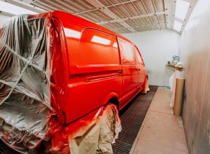 red-van-in-paint-booth-car-workshop-details-painti-UUQW2T5